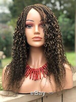 Braided Curly Wig. The Length In The Picture Is 18long. The Colors Are 4&27
